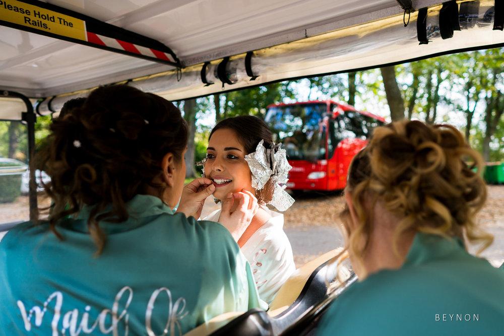 Bridesmaids check bride's teeth