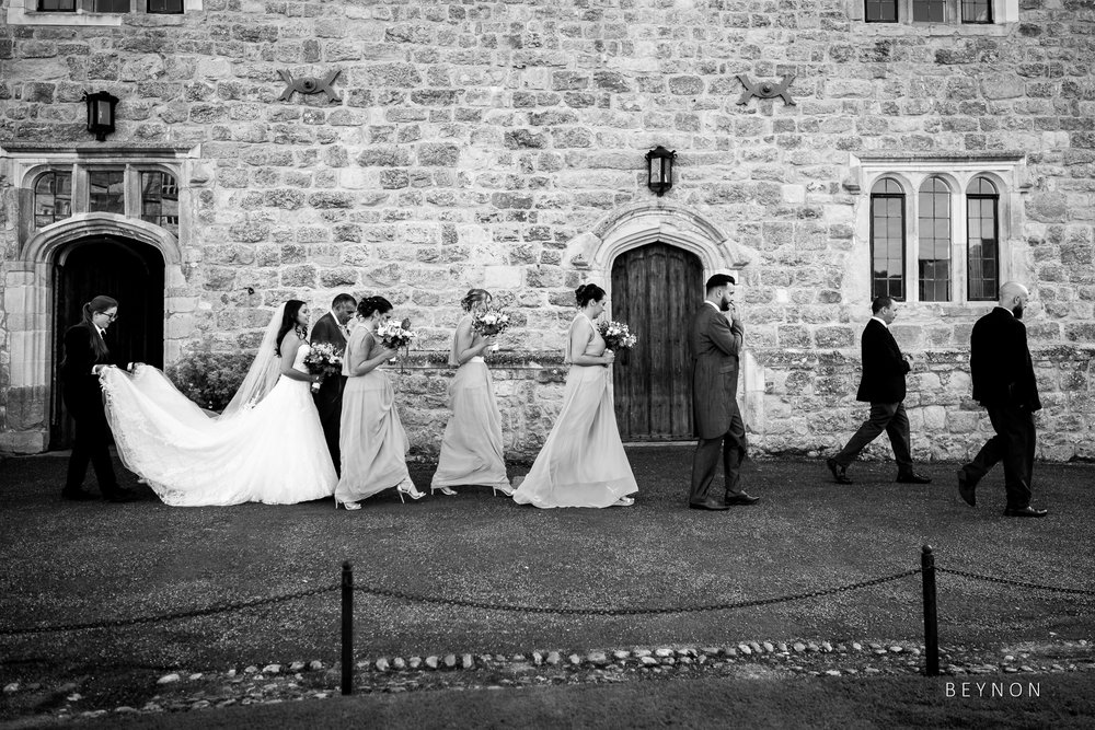 The bride and her bridesmaid walk to ceremony