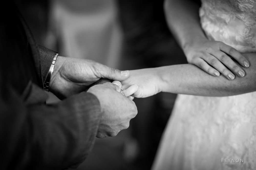 Groom places ring on bride's finger