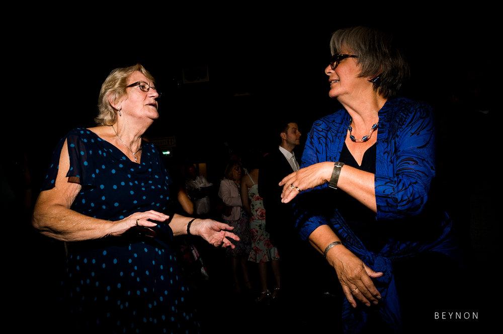 Elderly guests dance