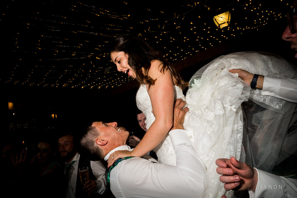 Groom lifts up bride