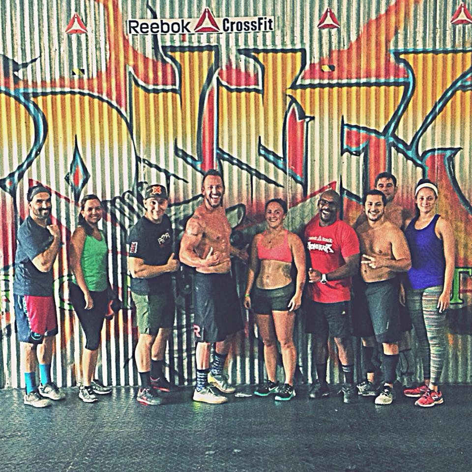 wild/STRONG founder Seth Waggener (middle) with girlfriend (in pink) during a drop-in at  Reebok Crossfit Iron Heart in San Juan, Puerto Rico.