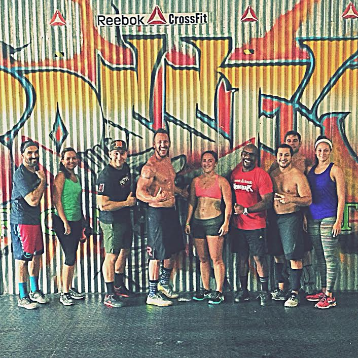 Founder, center, after logging for 100 days. Reebok Crossfit Ironheart, San Juan, Puerto Rico.