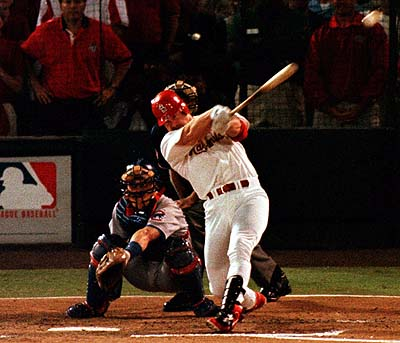 Big Mac crushing #62. His historic chase for the home run record in 1998 brought baseball back into the living rooms of America.