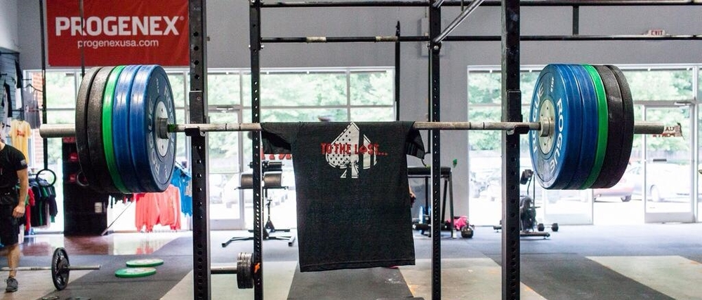 The morning after John died, our founder squatted this weight for a 5rm - the bar was left loaded on the rack all week in John's memory. See you in Valhalla JT.