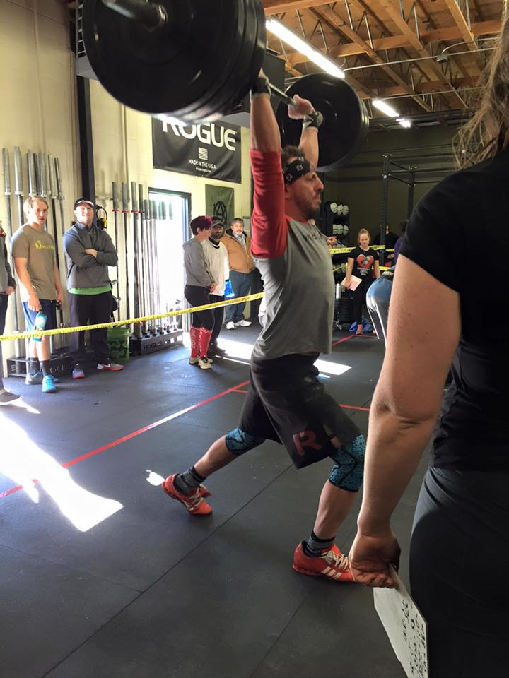 Founder hitting a 275 clean and jerk during event 2.