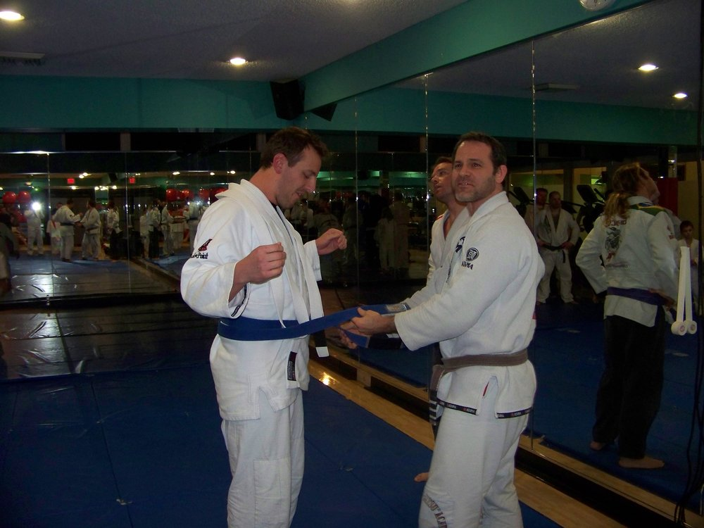 Relson Gracie Black Belt (at the time a brown belt) Shane Briggs, awarding me my blue belt at Jiu Jitsu Nation in Myrtle Beach, SC.