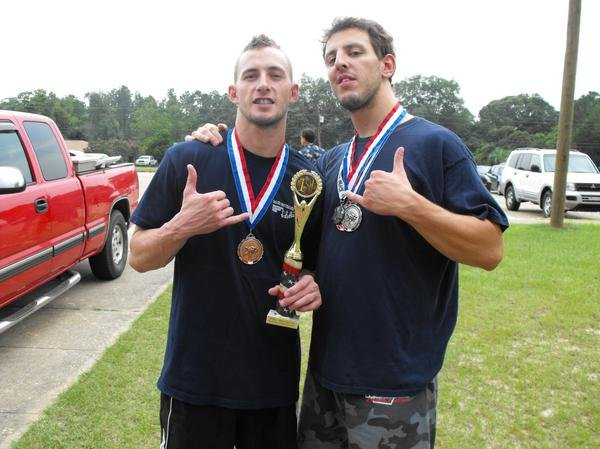 "Brazilian Jiu-Jitsu was my first passion when it came to fitness and improving my health. Here I am with my good friend Matt ""Care Bear"" Crump after we took down a competition in Dothan, AL."