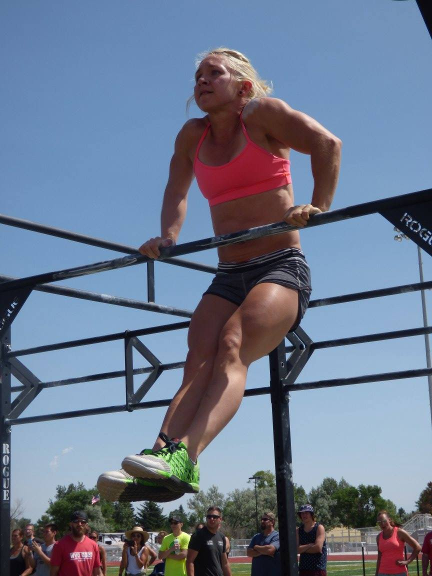 Newhart performs a bar muscle-up during the final event at last year's Wyoming Open. She cruised to an easy victory - the following year she tested positive for a PED and was banned for two years.