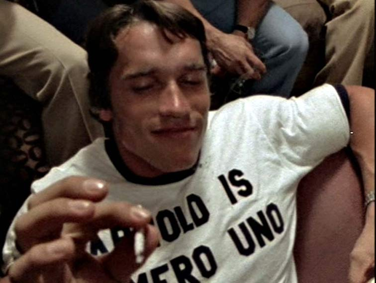 "Arnold enjoying a celebratory joint after winning Mr. Olympia in the documentary ""Pumping Iron."""