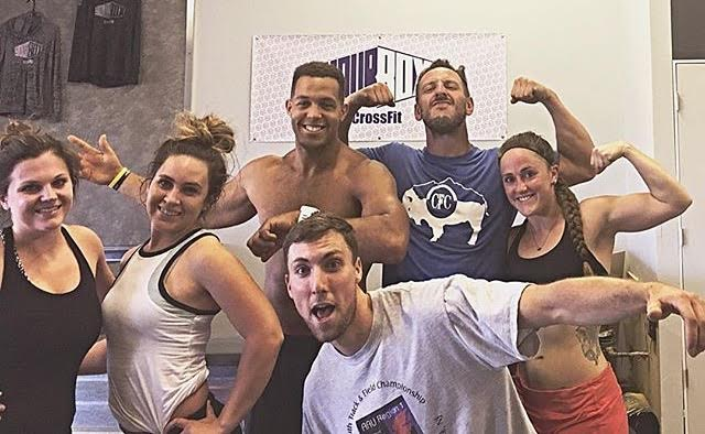 wild/STRONG Founder Seth Waggener (blue shirt) and Josie Pettipiece (right) with Malachi Bennett and the rest of the Your Box CrossFit crew during a drop-in this summer.