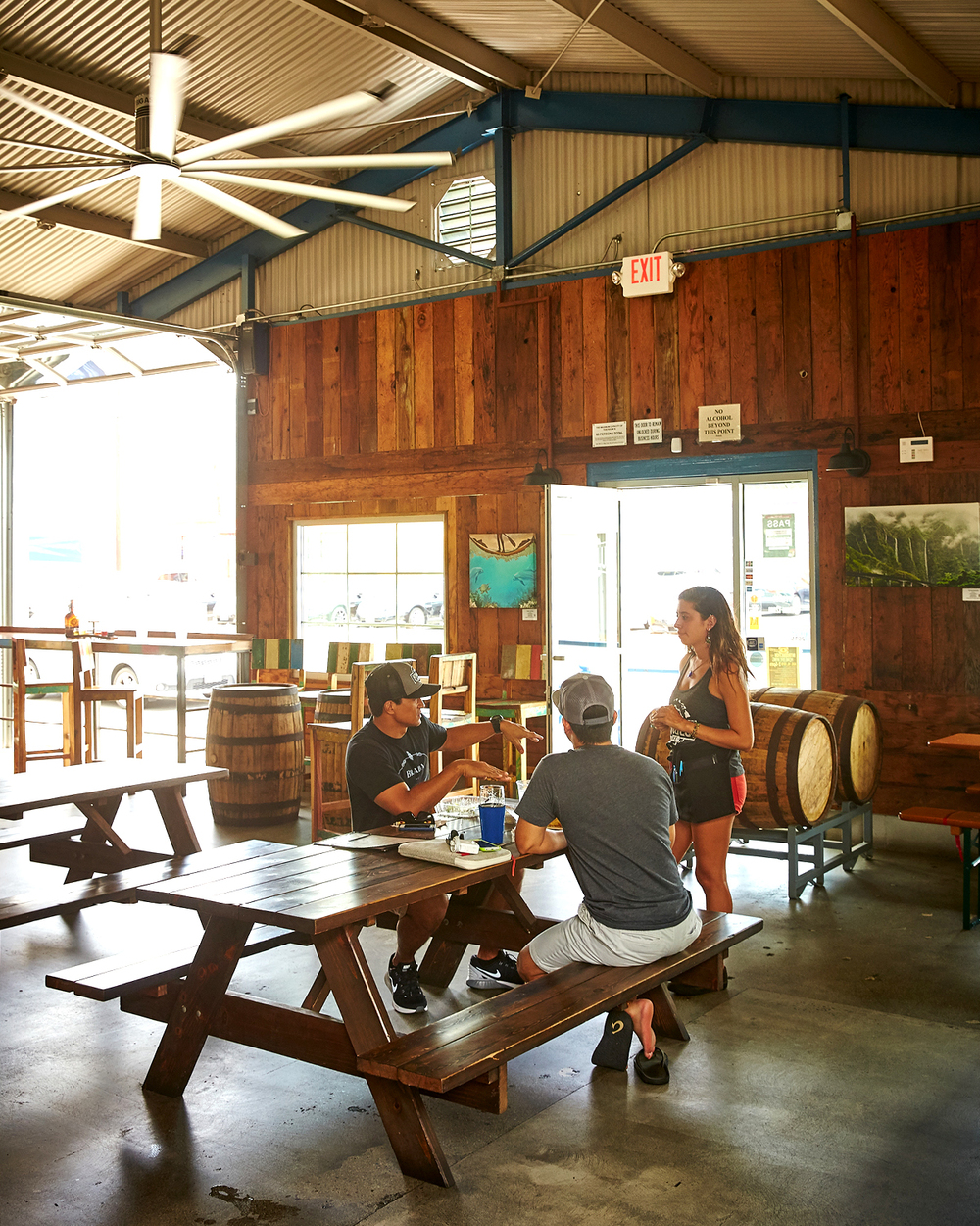 SURFERS TAKING LUNCH AT HONOLULU BEERWORKS