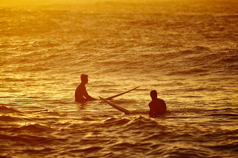 "SURFERS WAITING FOR ""THE ONE"" AT TURTLE BAY"