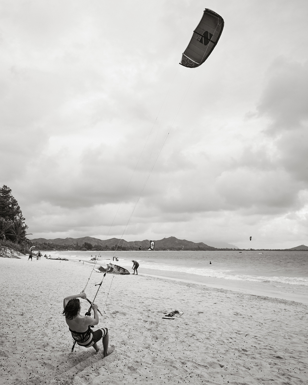 RAISING THE KITE AT KAILUA BEACH PARK