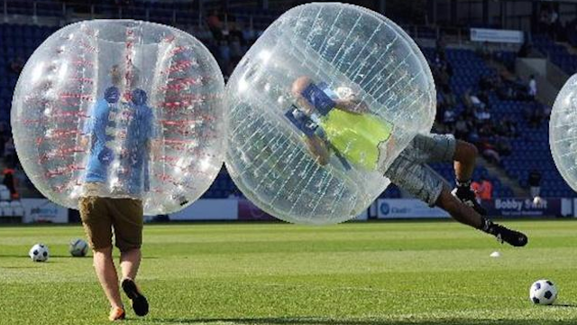 Diving Bubble Soccer boy in arena