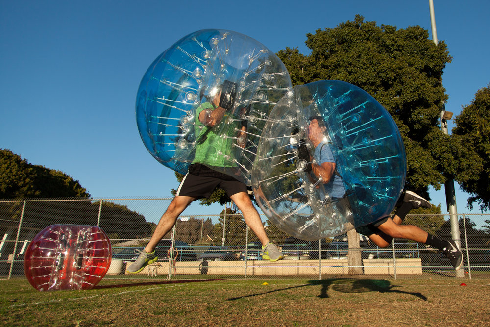 make sure to stay low when colliding with people in bubble soccer
