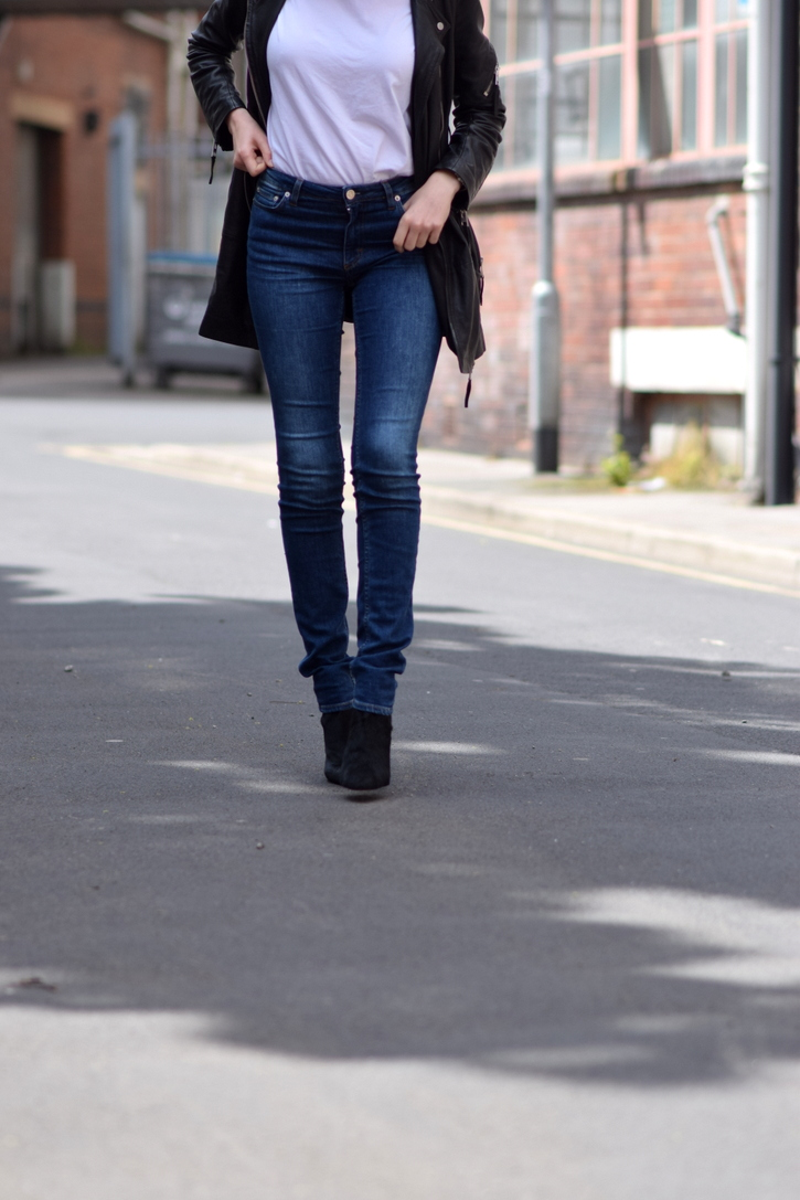 Long leg length jeans over black pointed boots
