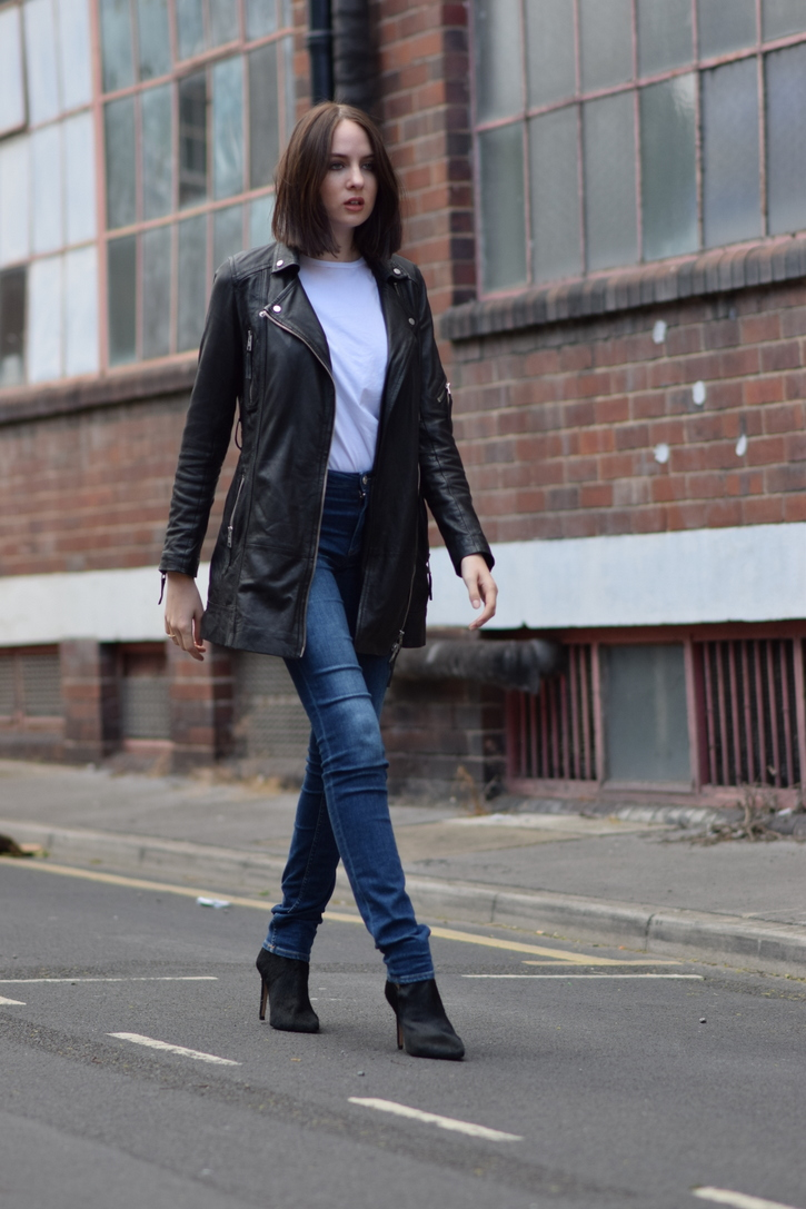 Black, white and denim outfit with heeled boots