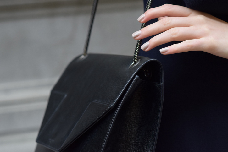 Nude painted nails with Saint Laurent black leather bag with chain strap
