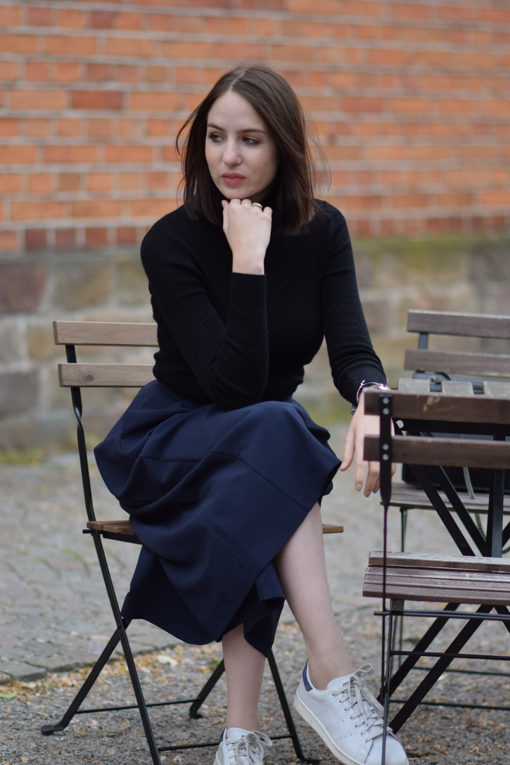 Black skinny turtleneck and navy blue wide legged culottes
