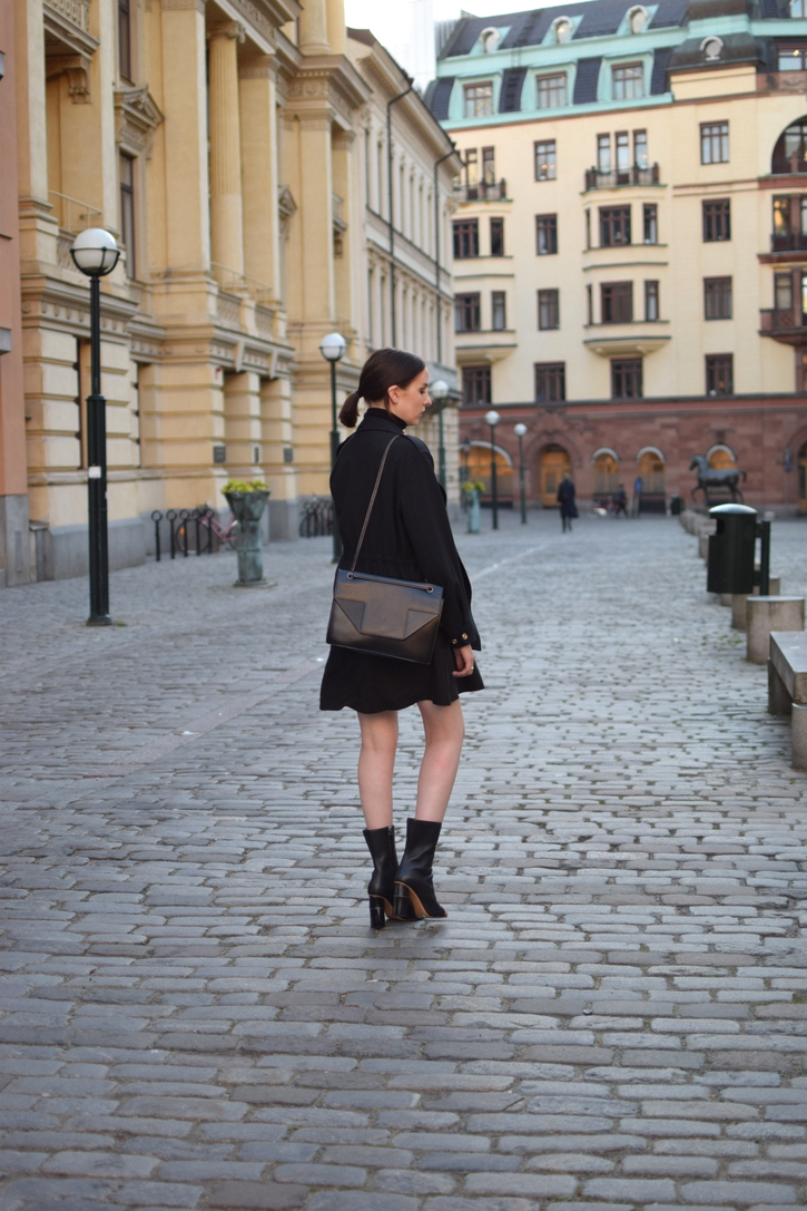 Black Acne boots with silk dress, black jumper and leather bag