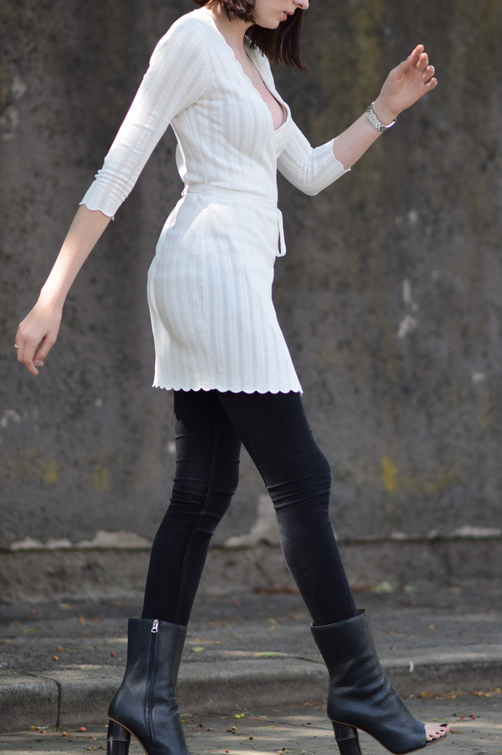 White dress worn over black skinny jeans