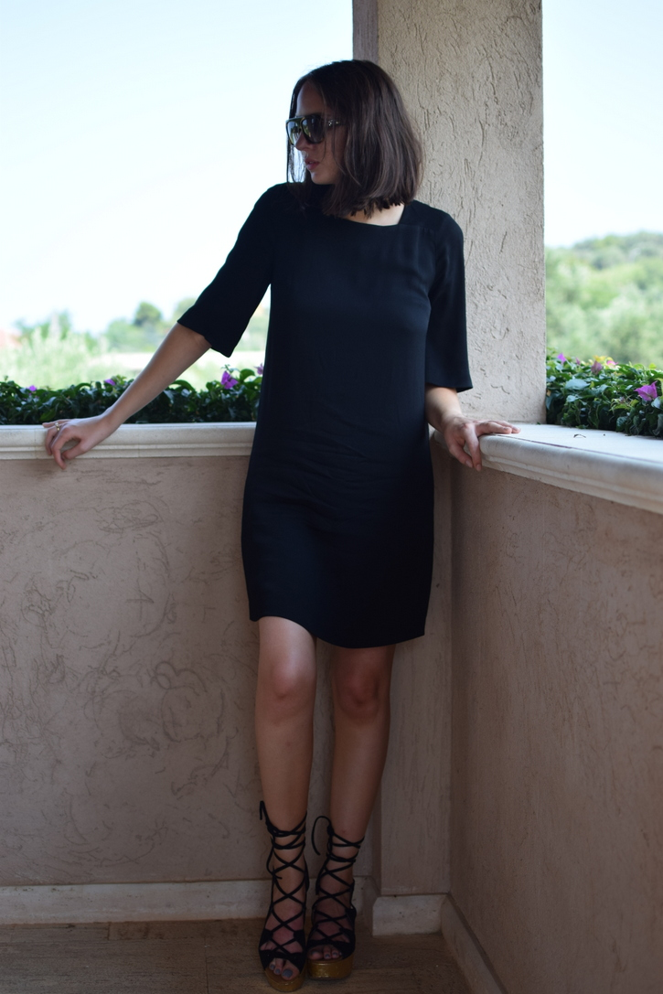 Holiday outfit black dress with statement sandals