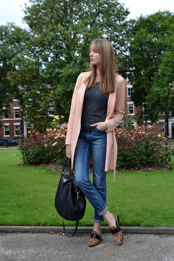 Pink coat, Grey tee, Baggy denim, Prada handbag, Leopard Loafers