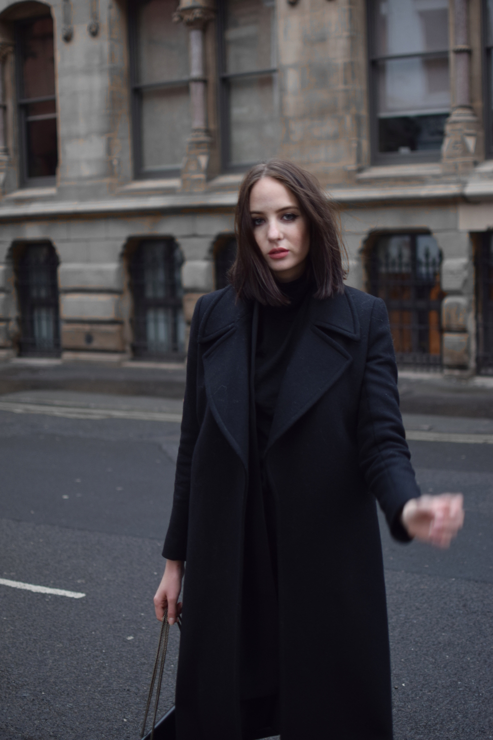 uk fashion blogger styling all black shot from the street