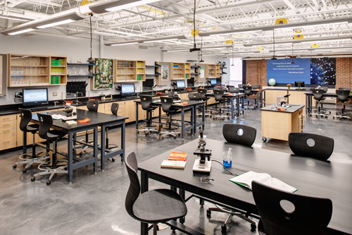 Rapidly reconfigurable furnishings allow students and instructors to move seamlessly from large group discussions to small group lab activities.