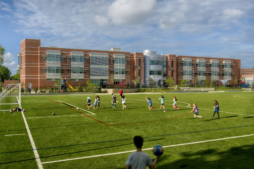 An artificial turf field invites active play and invites joint use by local community groups.