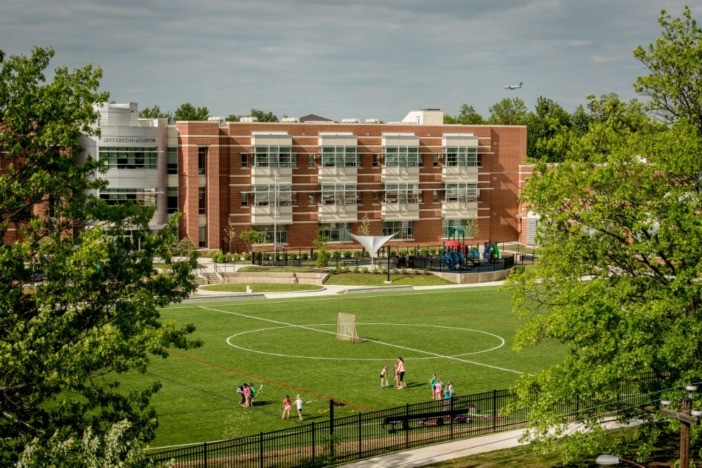 The new school is framed by the mature trees of its historic neighborhood in Old Town Alexandria.