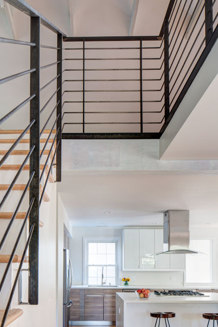 The open stair connects the main floor living area to the loft.