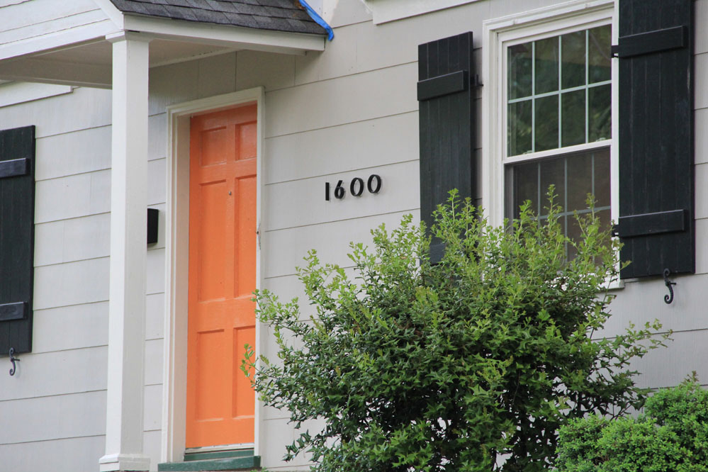 Custom wood shutters and shutter dogs add authenticity to the exterior.