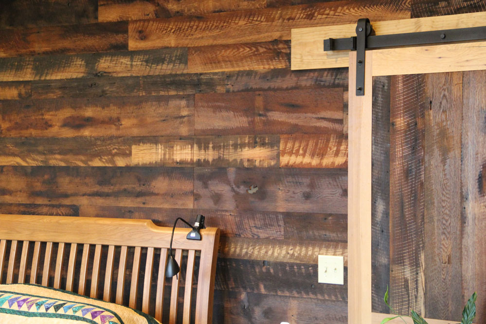 Reclaimed Granary Oak and Hickory create a unique barn door leading to the master bedroom and walk-in closets.