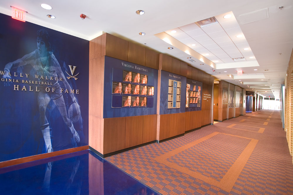 Duotone graphics and stained concrete floors welcome visitors to UVa's Sports Hall of Fame.