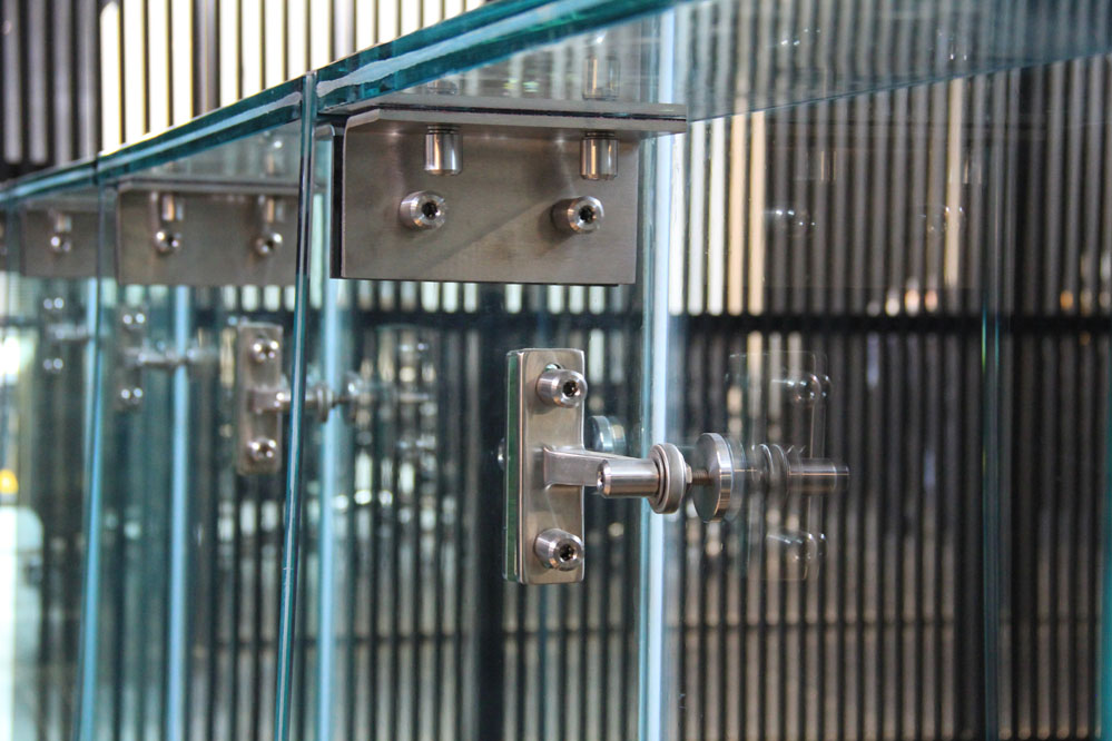 A structural glass wall provides a transparent, but secure separation between the public lobby and the team areas.