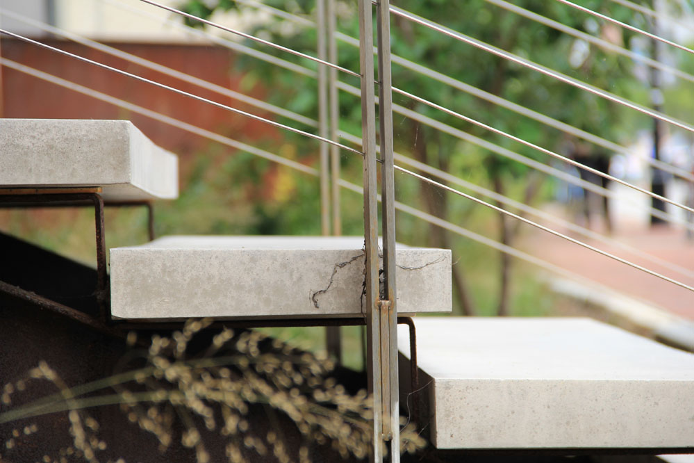 The carefully detailed stair is composed of precast conrete and stainless steel.