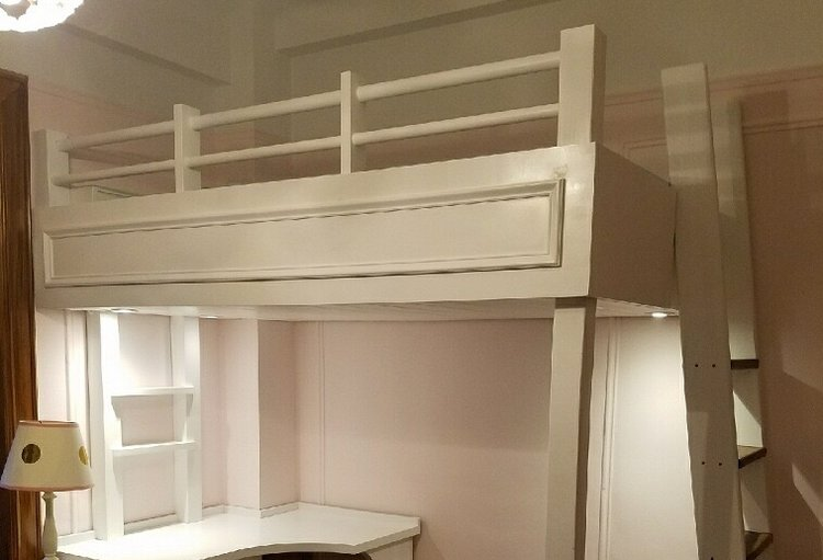 White lacquer finish, on custom loft and desk. Recessed LED lights and switch. Solid American Black Walnut on steps of ships ladder. Custom moulding on fascia to match existing on the walls of this classic Pre-War UWS apartment.