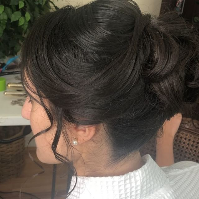 #flashback to this #bridalhair beauty on this rainy Friday. Mrs. M opted for a classic updo to complete her look.