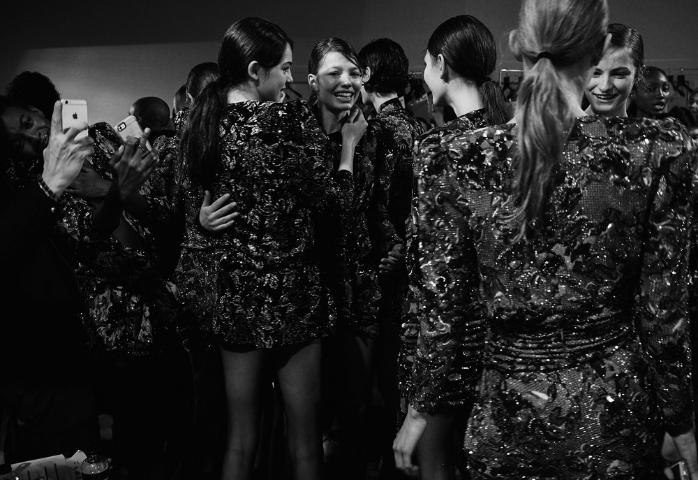 Models hugging after the Saint Laurent finale