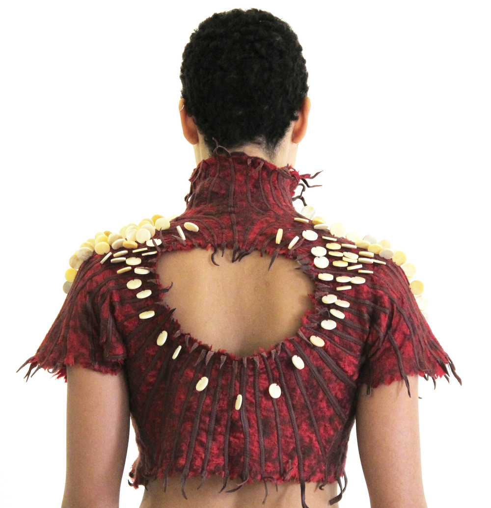 Silk garment with needle-felted wool, leather strips, and bone beads.