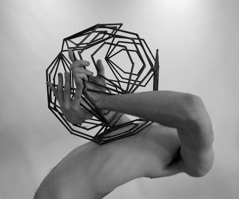 Welded iron polygon.