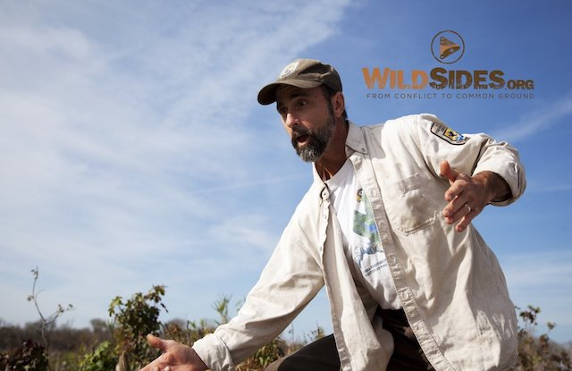 Photo 6: Chris Joking Around in the Field. This is a high resolution photo by Jeffrey Mittelstadt and is not a screenshot from the film. We will remove the WildSides.org watermark.