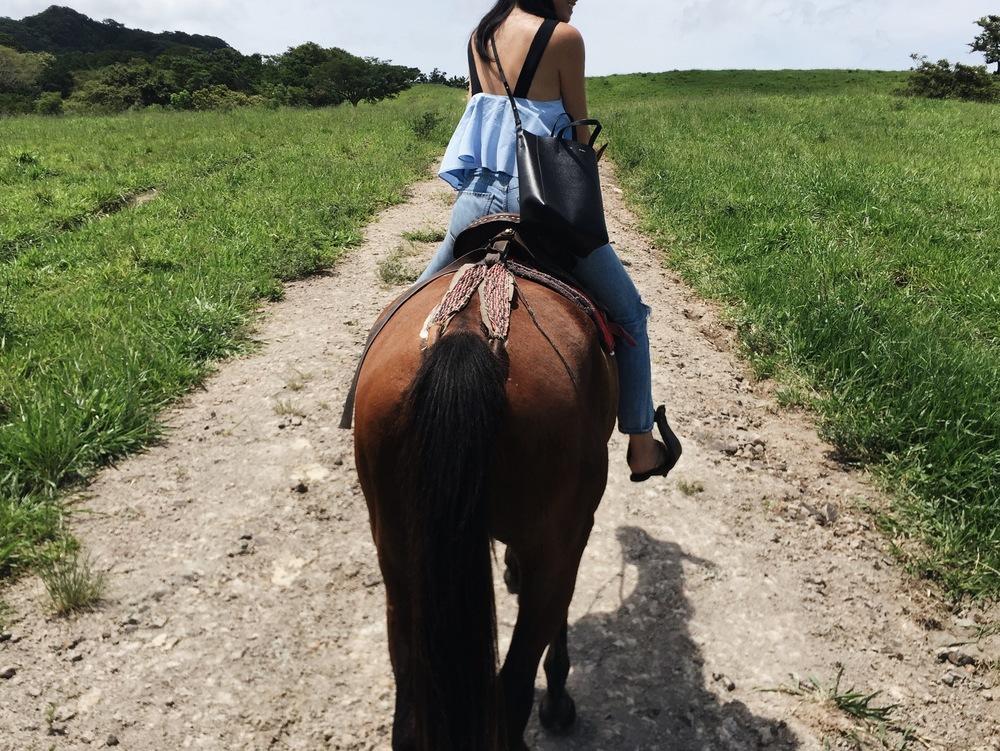 Horseback riding in Borinquen, Costa Rica. ZARA Top /CITIZENS OF HUMANITY Jeans/CÉLINE Bag