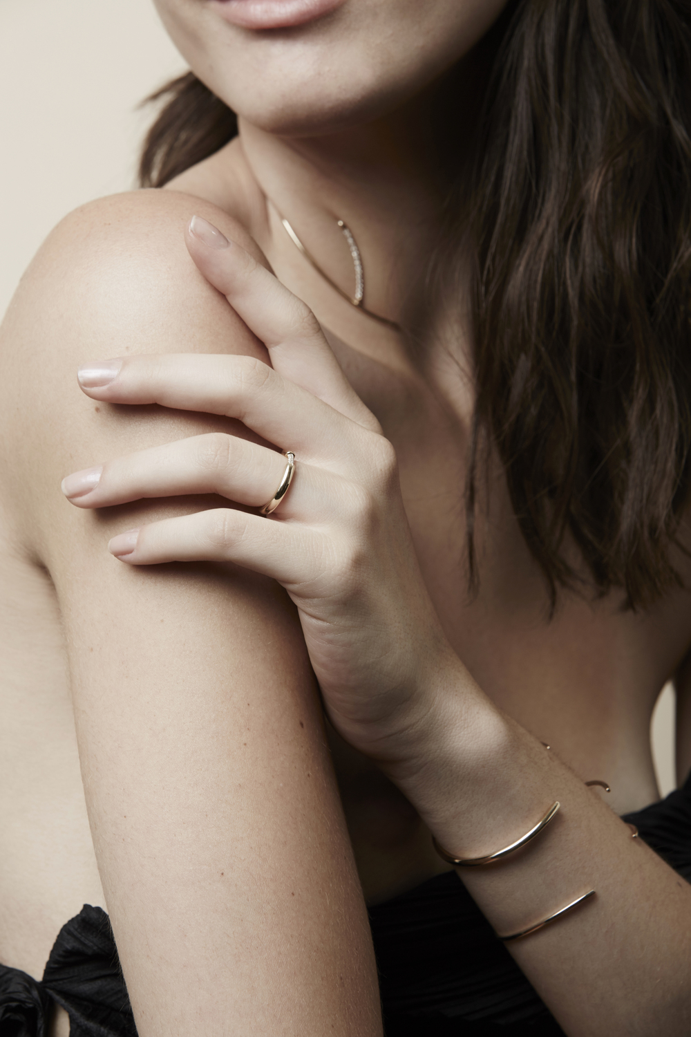 Wishbone Choker  ,   Cerre Pavé Band  ,   Wishbone Cuff   / Photography by   Helen Eriksson ,  Styling by   Lexi Rose ,  Model Stefany Basso.