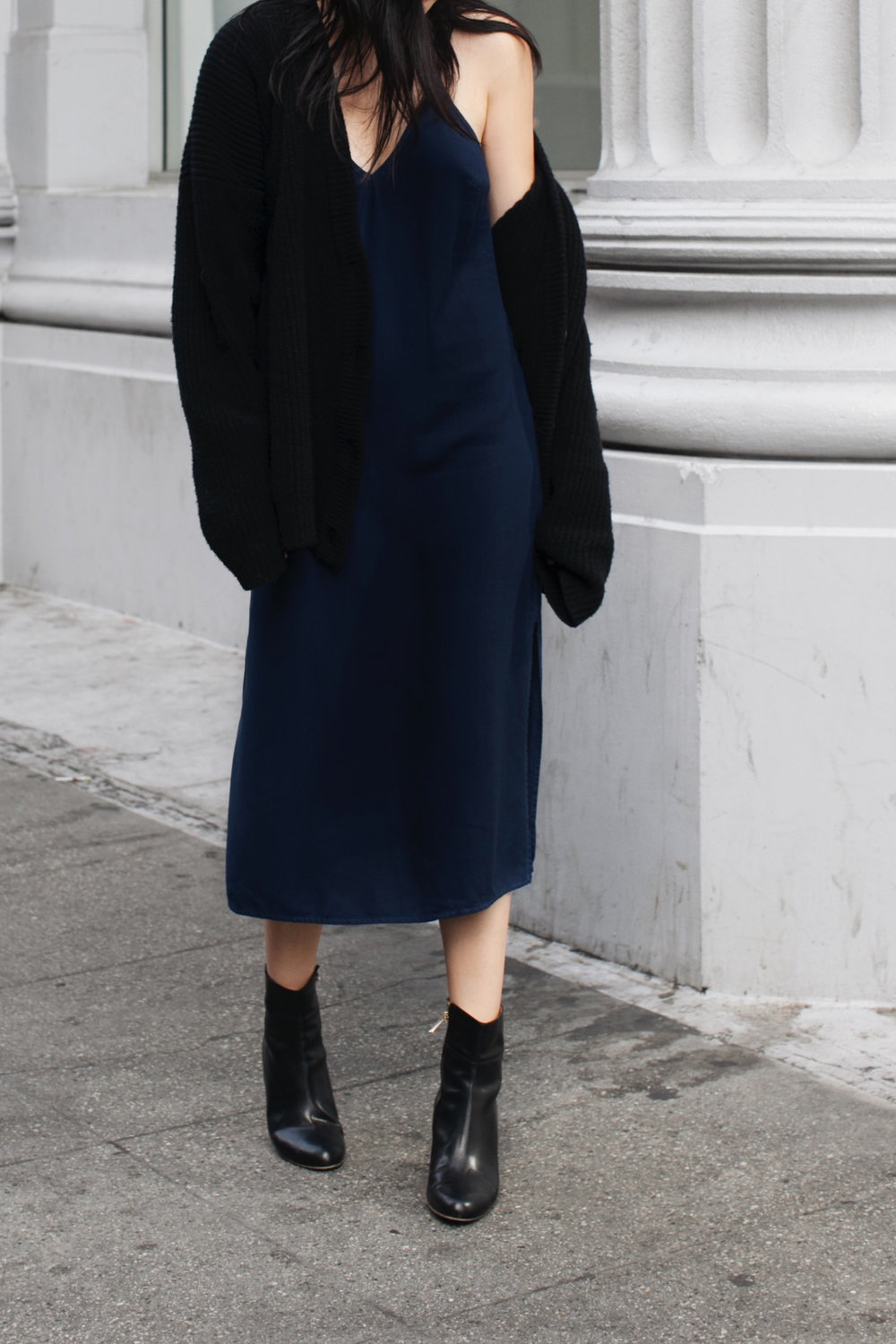 Semi polished look wearing the slip with an oversized cardigan and boots.