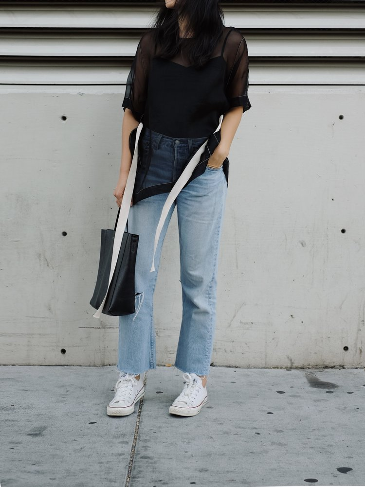 BASSIKE Top / LEVIS Vintage Denim (Similar here) / CONVERSE Sneakers / CÉLINE Bag — See post here