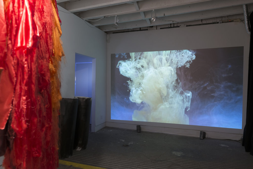 Elin Melberg    Float (red) , 2015 Torn textile, embroidery, dry pastel, wood Dimensions variable   Per Christian Brown    Earth and Reveries of Repose - Reveries of Material Interiority , 2015 HD video, Edition: 5