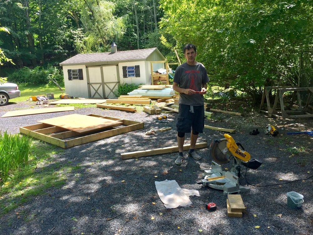 Brian, hard at work on starting the coop. That is a bit of the floor, behind him!